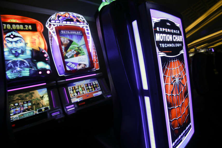 A slot machine is featured in this AP file photo. The Midland County Sheriff's Office seized 52 gambling machines Friday on Andrews Highway.  Photo: ISAAC BREKKEN