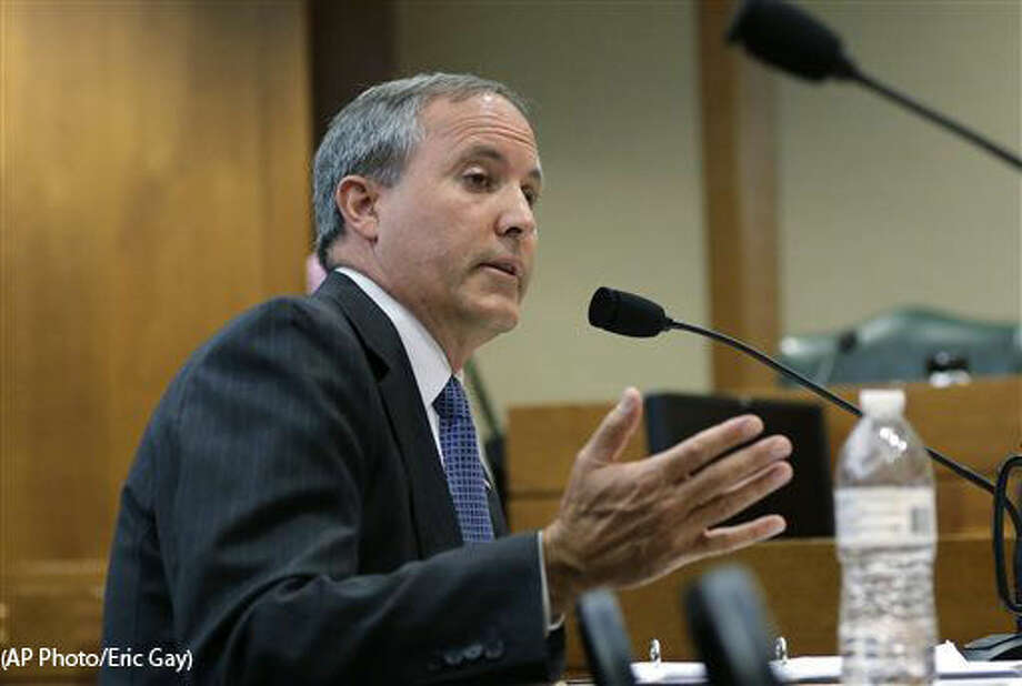FILE - In this July 29, 2015 file photo, Texas Attorney General Ken Paxton speaks during a hearing in Austin, Texas. Already indicted on felony securities fraud charges, Paxton will face an ethics investigation for advising local officials they could refuse to issue same-sex marriage licenses on religious grounds. (AP Photo/Eric Gay)
