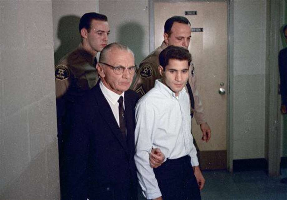 FILE - This June 1968 file photo shows Sirhan Sirhan, right, accused assassin of Sen. Robert F. Kennedy with his attorney Russell E. Parsons in Los Angeles. For nearly 50 years, Sirhan Sirhan has been consistent: He says he doesn't remember fatally shooting Sen. Kennedy in a crowded kitchen pantry of the Ambassador Hotel in Los Angeles. The Jerusalem native, now 71, has given no inkling that he will change his version of events at his 15th parole hearing on Wednesday, Feb. 10, 2016, in San Diego. He is serving a life sentence that was commuted from death when the California Supreme Court briefly outlawed capital punishment in 1972. (AP Photo/File) Photo: Anonymous