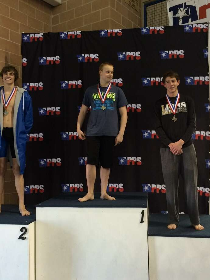 Midland Christian senior Kyle Martin, middle, stands at the podium with his gold medal after winning the 200 freestyle at the TAPPS Swimming Championships in San Antonio on Friday. Courtesy Photo.