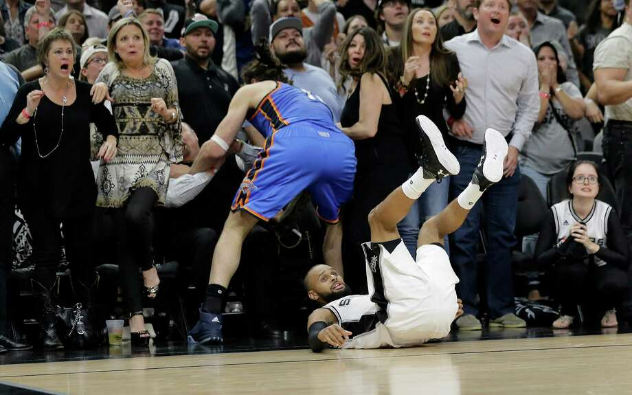 Spurs guard Patty Mills falls to the floor as he watches his last shot miss during the final seconds of Game 2 in the playoff series between the Spurs and the Thunder. A reader blasts the officiating in the game. Photo: Eric Gay /Associated Press / AP