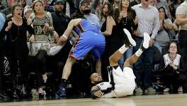 Spurs guard Patty Mills falls to the floor as he watches his last shot miss during the final seconds of Game 2 in the playoff series between the Spurs and the Thunder. A reader blasts the officiating in the game.
