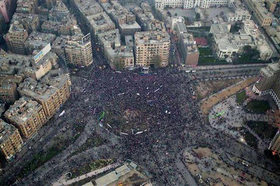 This aerial image made from an Egyptian army helicopter shows a general view of a pro-military rally marking the third anniversary of the uprising that toppled autocrat Hosni Mubarak in Tahrir Square in Cairo, Egypt, Saturday, Jan. 25, 2014. Egyptian riot police have fired tear gas to disperse hundreds of supporters of ousted Islamist President Mohammed Morsi protesting as the country marks the third anniversary of the 2011 uprising, as supporters of the military gathered in rival rallies in other parts of the capital, many of them urging military chief Gen. Abdel-Fattah el-Sissi, the man who removed Morsi, to run for president.(AP Photo/Hassan Ammar) Photo: Hassan Ammar / AP