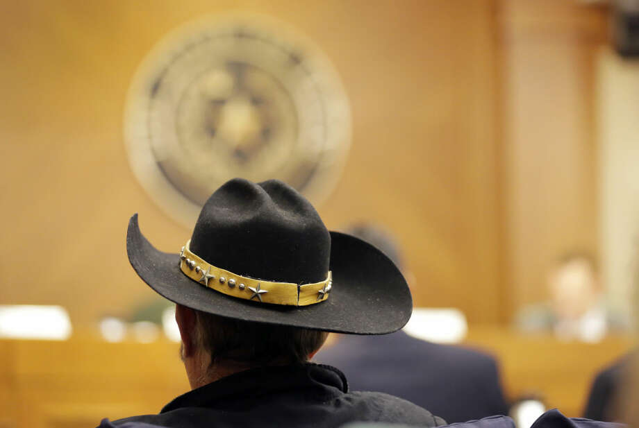 Jerry Williams waits to give testimony at a hearing where lawmakers discuss whether to legalize concealed handguns on college campuses and open carry everywhere, Thursday, Feb. 12, 2015, in Austin, Texas. More than 100 people waited under heightened security at the Capitol to testify on looser firearm laws that Republicans have prioritized under new Gov. Greg Abbott. (AP Photo/Eric Gay) Photo: Eric Gay