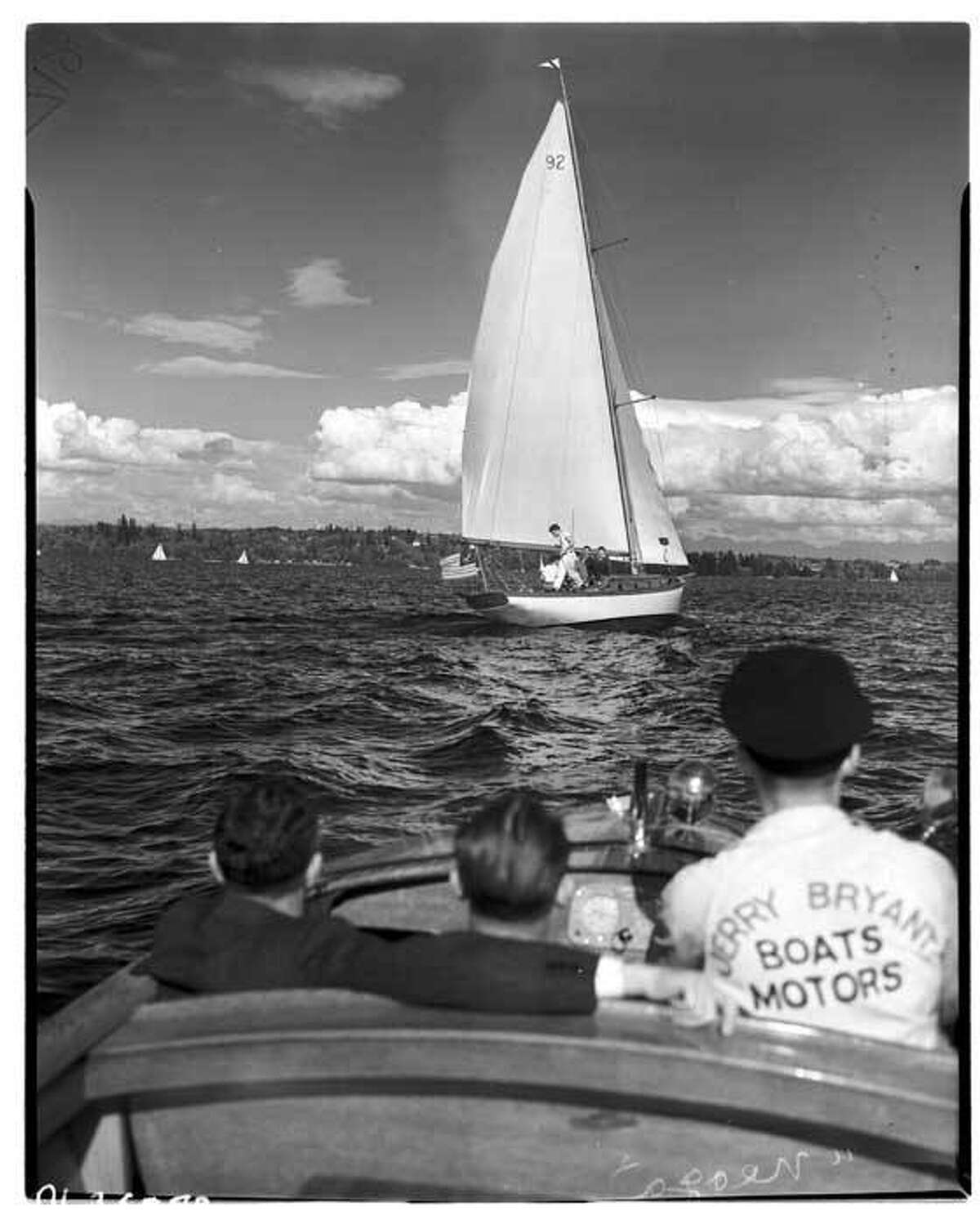 """Sailboat """"Neoga"""" as seen from a from motorboat in May 1941 off of Seattle."""