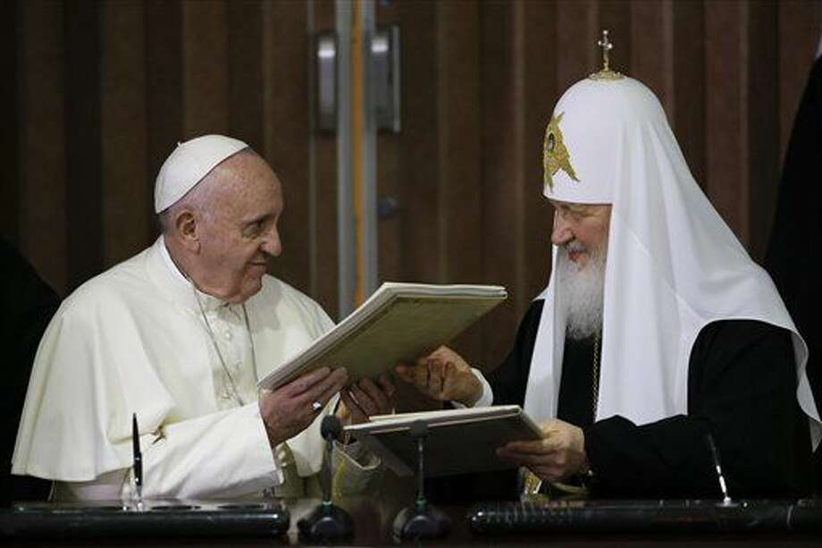 Pope Francis, left, and Russian Orthodox Patriarch Kirill exchange a joint declaration on religious unity at the Jose Marti International airport in Havana, Cuba, Friday, Feb. 12, 2016. The two religious leaders met for the first-ever papal meeting, a historic development in the 1,000-year schism within Christianity. (AP Photo/Gregorio Borgia, Pool) Photo: Gregorio Borgia