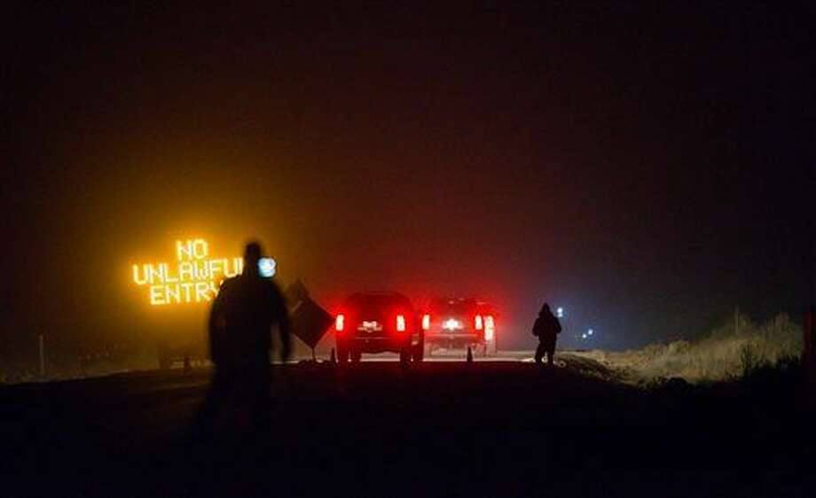 Three SUV proceeds through the Narrows roadblock near Burns, Ore., as FBI agents have surrounded the remaining four occupiers at the Malheur National Wildlife Refuge, on Wednesday, Feb.10, 2016. The four are the last remnants of an armed group that seized the Malheur National Wildlife Refuge on Jan. 2 to oppose federal land-use policies. (Thomas Boyd/The Oregonian via AP) Photo: Thomas Boyd