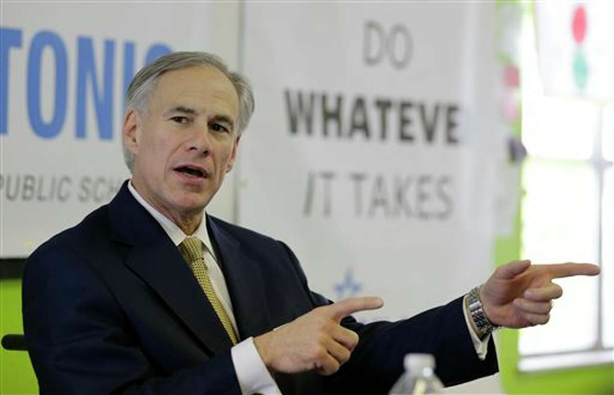 FILE - In this Dec. 11, 2013 file photo, Republican Attorney General Greg Abbott talks with educators at KIPP: San Antonio, in San Antonio, Texas. Abbott raised $11.5 million over three months, and Fort Worth Democrat Wendy Davis raised more than $12 million over the past six months, the campaigns reported Tuesday, Jan. 14, 2014. (AP Photo/Eric Gay, File)