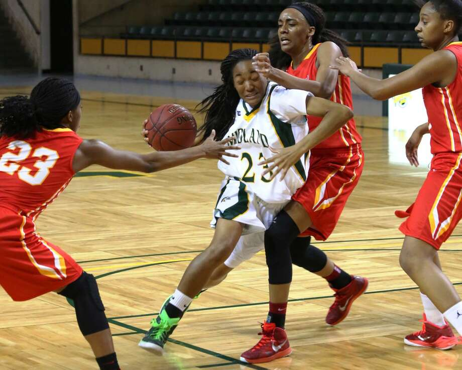 Midland College's Mary Savoy drives to the basket against New Mexico Junior College defenders in the Lady Chaps' 58-54 victory, Monday at Chaparral Center. Forrest Allen/MC Athletics