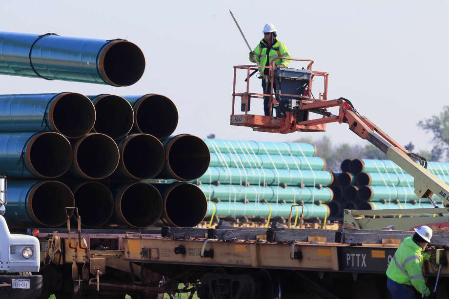 In this May 9, 2015 file photo, workers unload pipes at a staging area in Worthing, S.D., for the proposed Dakota Access Pipeline that would stretch from the Bakken oil fields in North Dakota through South Dakota and Iowa to a hub in Illinois. On Monday, Nov. 30, 2015, the South Dakota Public Utilities Commission is meeting to discuss whether to grant a construction permit for the 1,130-mile pipeline that would move at least 450,000 barrels of crude daily from the Bakken oil patch. (AP Photo/Nati Harnik, File) Photo: Nati Harnik