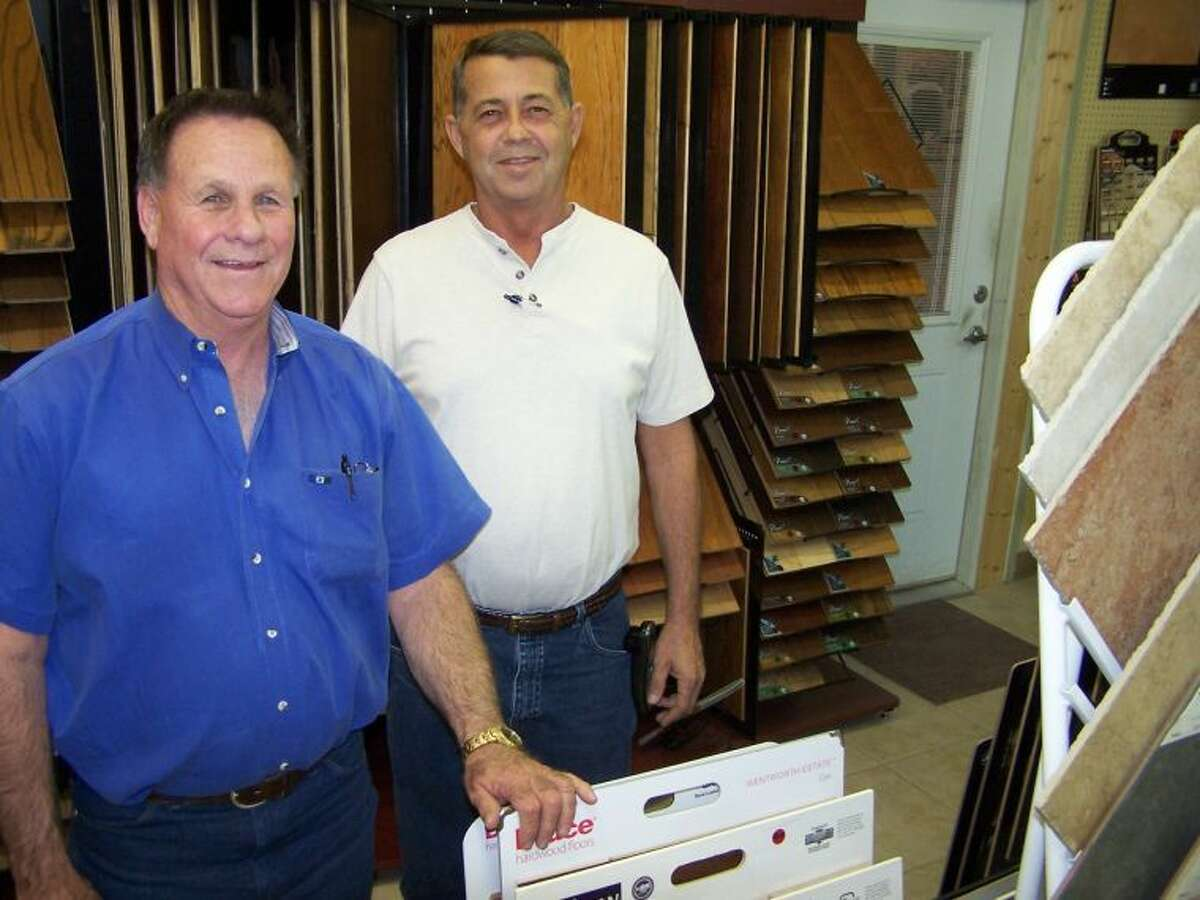 Travis Kendrick, left, and Tebo Vaughn say summer is a great time to replace flooring. See them at Southwest Floors, 1113 Andrews Highway in Midland.