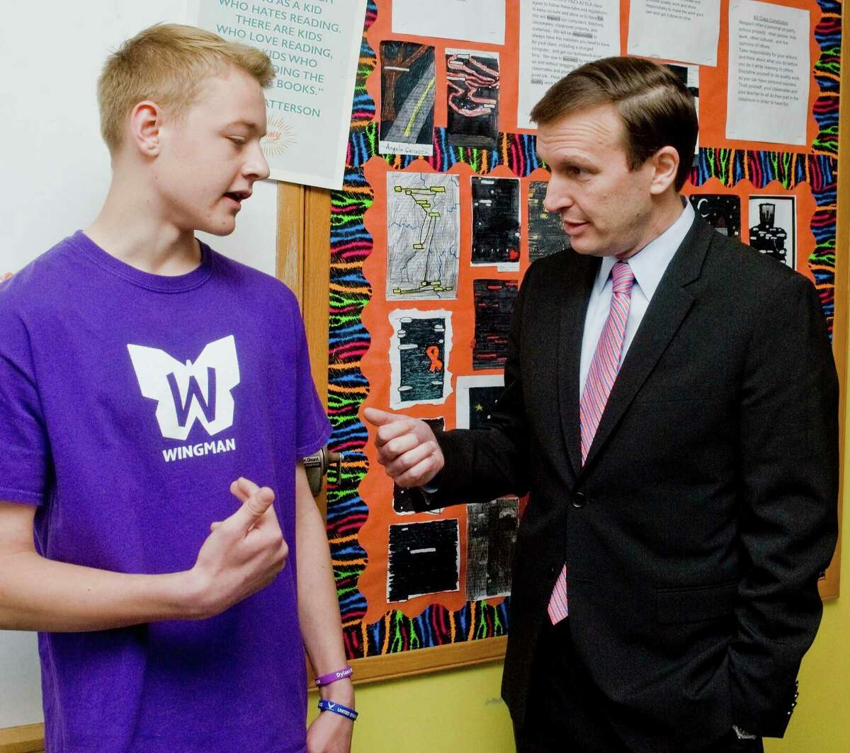 Wilson Brawley, eigth-grade, explains the classroom activities of the Wingman program to Senator Chris Murphy as he visited New Fairfield Middle School for the culmination of their Wingman program, a student-led leadership program founded by Sandy Hook parents, Ian and Nicole Hockley, in memory of their son Dylan. Friday, May 6, 2016