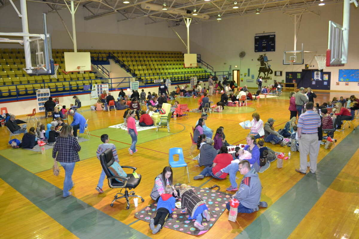 Greenwood Elementary teachers and staff hosted Fall in Love with Reading Café Thursday at school's gym.