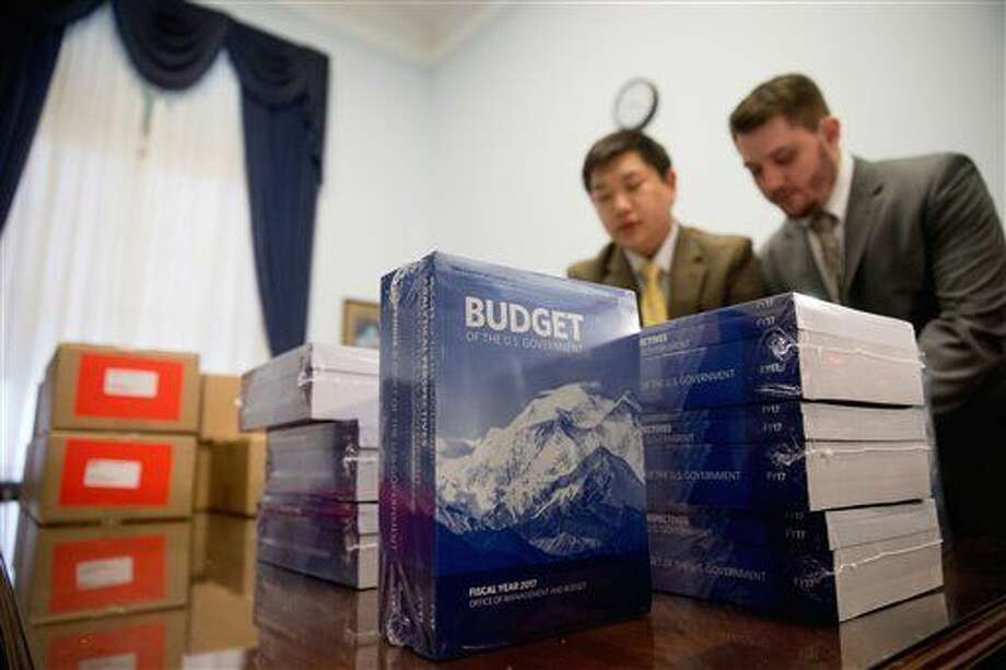 Copies of the President Barack Obama's fiscal 2017 federal budget are unpacked after being delivered to the House Budget Committee Room on Capitol Hill in Washington, Tuesday, Feb. 9, 2016. President Barack Obama unveils his eighth and final budget, a $4 trillion-plus proposal that's freighted with liberal policy initiatives and new and familiar tax hikes, sent to a dismissive Republican-controlled Congress. (AP Photo/Andrew Harnik) Photo: Andrew Harnik