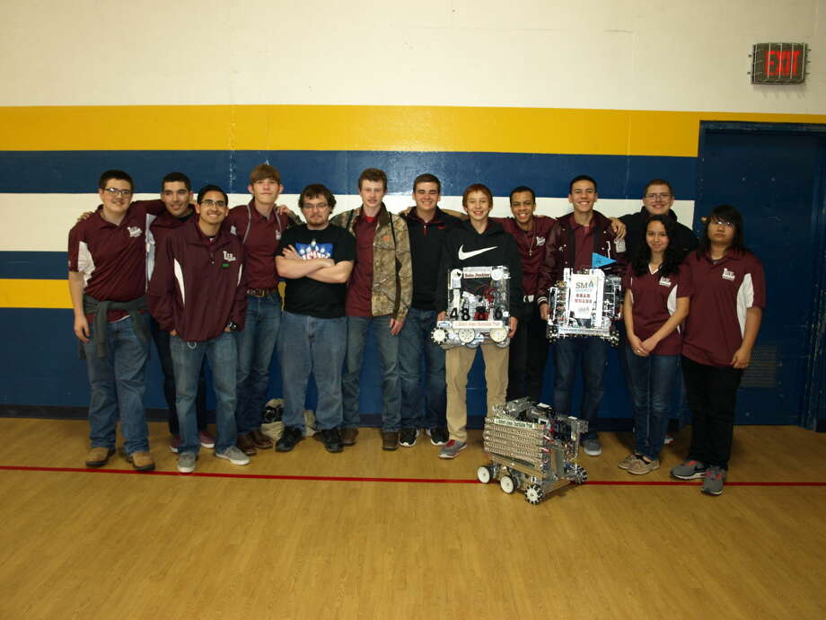 Lee High School graduate and former robotics team member Brian Kitchens, fifth from left, is mentoring this year's team. Members are Tate Blondin, from left, Chris Lozano, Augustine Esquivel, Daniel Shaffer, Dylan Stoope, Isaac Tidwell, Jordan Snodgrass, Juwon Packer, Elijah Tate, Rebecca Aranda, Kimberly Soun and Britton Corbett, back.