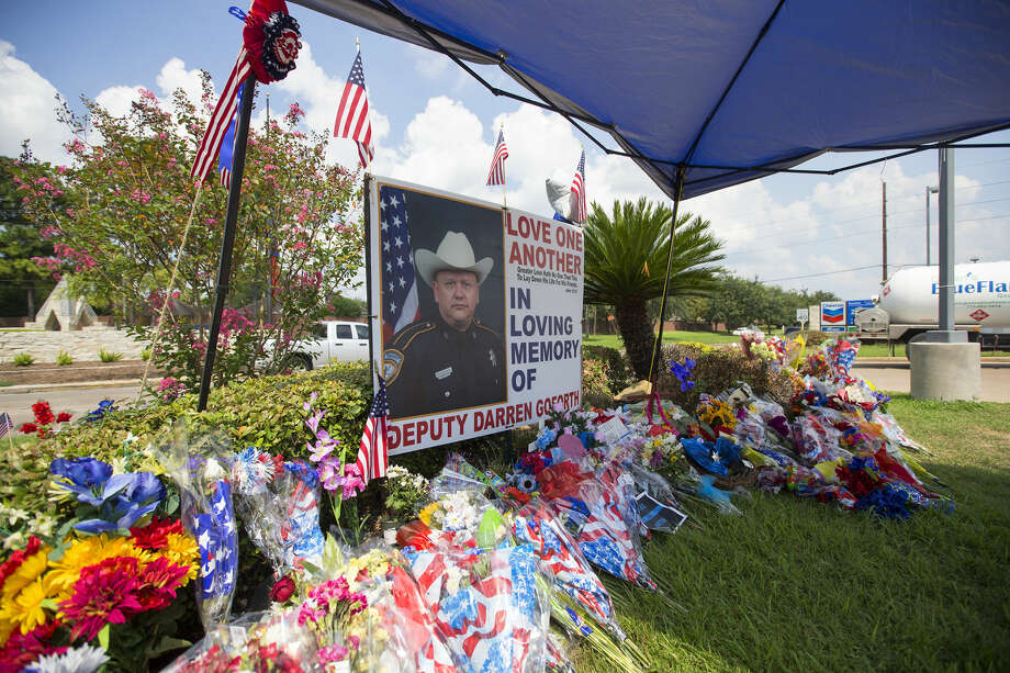 The memorial of Harris County Sheriff's Deputy Darren Goforth is seen at the intersection of West Road and Telge, Tuesday, Sept. 8, 2015, in Houston. The memorial for Deputy Goforth has moved to the grass from pump 8 where it was originally located. Deputy Goforth was fatally shot as he pumped his cruiser with gas Friday, Aug. 28. (Cody Duty / Houston Chronicle) Photo: Cody Duty