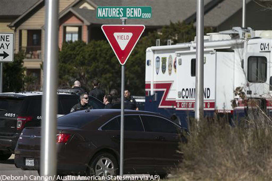 Austin Police Department officers investigate the scene of an officer involved shooting in the 12000 block of Natures Bend in northeast Austin, Texas on Monday, Feb. 8, 2016. Police said 17-year-old David Joseph, an unarmed nude teenager, was fatally shot by Officer Geoffrey Freeman when the teen refused orders to stop and then charged at the officer. (Deborah Cannon/Austin American-Statesman via AP) Photo: Deborah Cannon