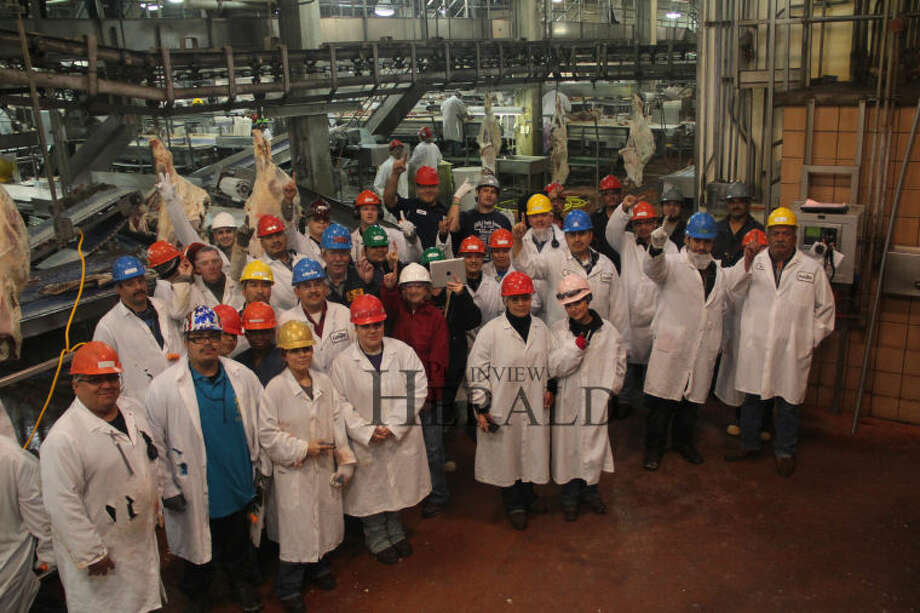 Cargill workers pause and manage to smile for the camera on their final day. Photo: Photo Courtesy Cargill