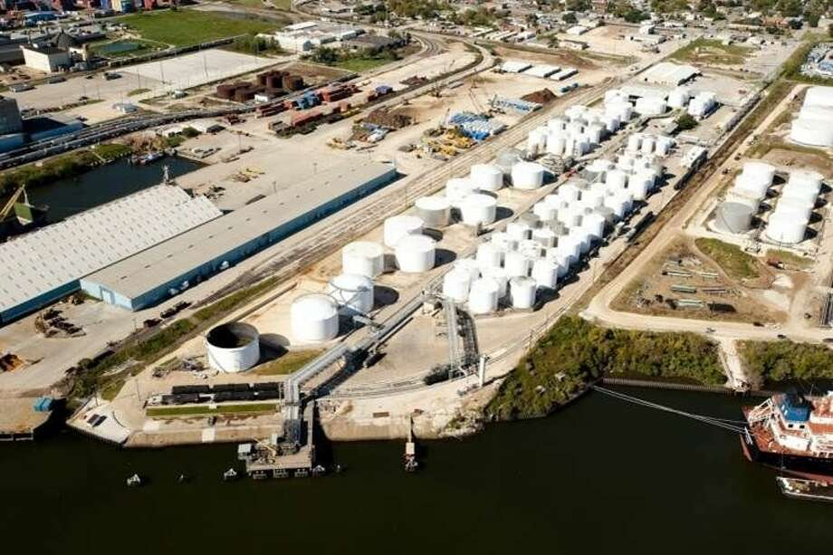 Kinder Morgan Inc. said on Feb. 9, 2015 that it would acquire a 36-acre, 1,069,500-barrel storage complex at Galena Park in part of a $158 million deal with Dutch midstream company Royal Vopak. The Houston Ship Channel facility, adjacent to a Kinder Morgan complex shown at right in the photo, handles base oils, biodiesel and crude oil. Kinder Morgan, a Houston-based pipeline and storage company, also acquired two terminals in North Carolina and an undeveloped waterfront site in Perth Amboy, New Jersey, in the deal with Vopak. (Kinder Morgan photo) Photo: Kinder Morgan Inc.
