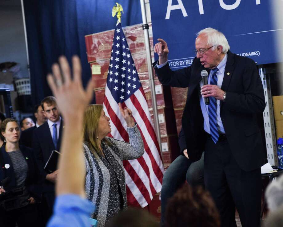Democratic presidential candidate Bernie Sanders' wife Jane Sanders interrupts her husband to let him know he has gone over time and is late for his next speaking engagement on Thursday. For the good of the party, Sanders should admit the inevitable and withdraw from the race. Photo: Christian Randolph /Associated Press / Charleston Gazette-Mail