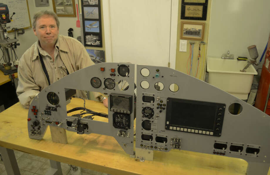 Robert Laughlin shows off the cockpit instrument panels for XCOR he built in his workshop. Tim Fischer\Reporter-Telegram Photo: Tim Fischer