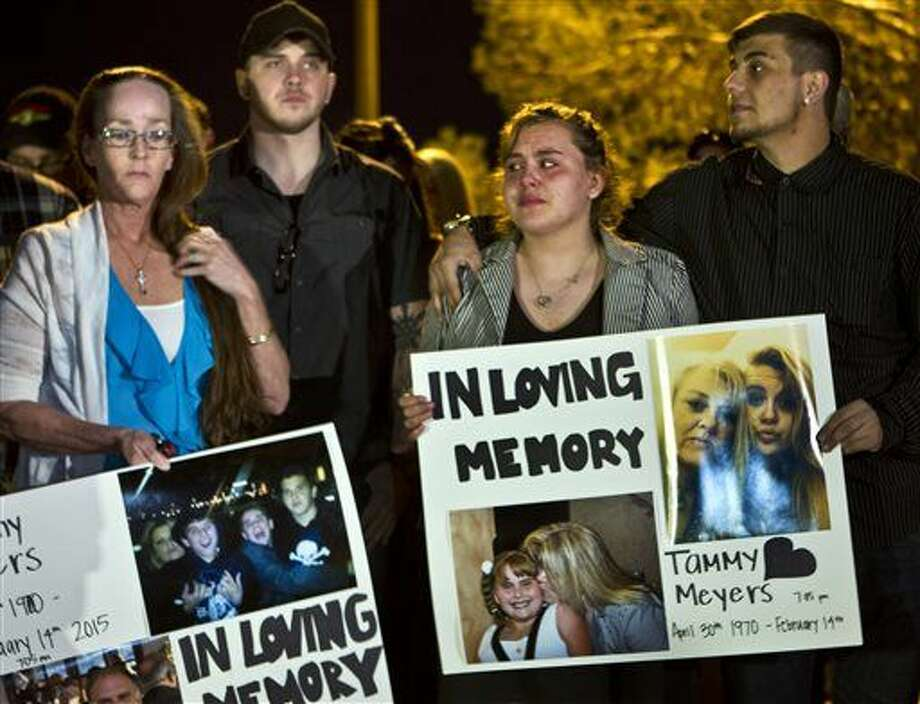 In this Tuesday, Feb. 17, 2015, photo, people participate in a candlelight vigil for Tammy Meyers, who was taken off life support on Saturday after a shooting in Las Vegas. What police first described as a road rage-inspired shooting of an innocent mother of four has morphed into a more complex scenario, prompting a backlash Wednesday against the Las Vegas family and the way the case is being handled. (AP Photo/Las Vegas Sun, L.E. Baskow) LAS VEGAS REVIEW-JOURNAL OUT Photo: L.E. Baskow