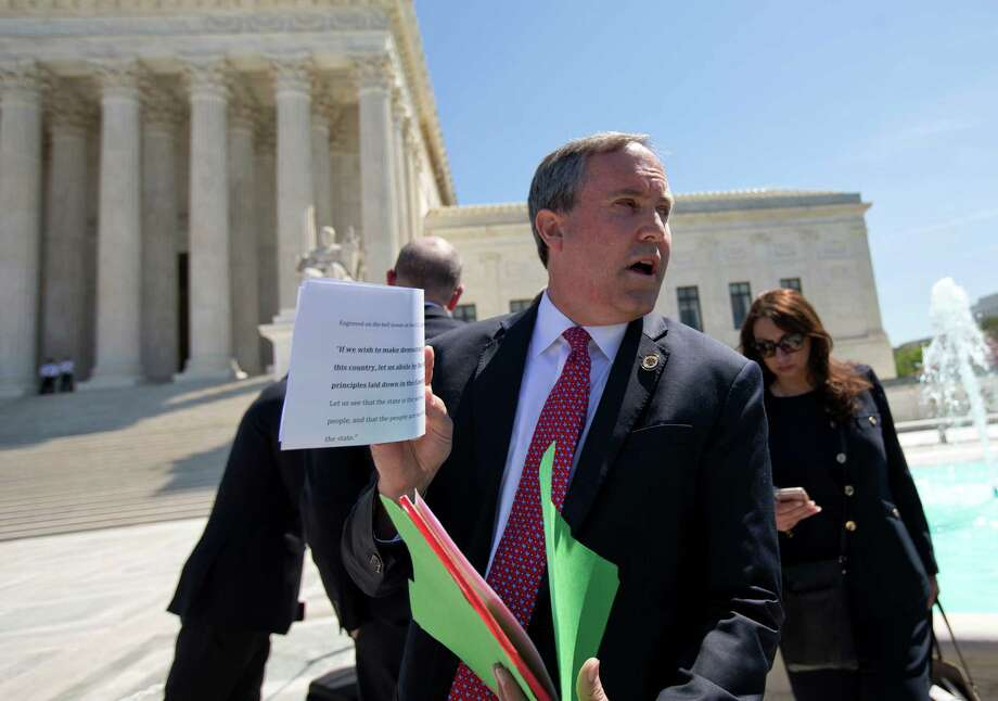 Texas Attorney General Ken Paxton speaks to the media in front of the U.S. Supreme Court, where justices took up a dispute over immigration last month. A reader criticizes Paxton after reports surfaced that he continued to pay an aide after his resignation. Photo: Pablo Martinez Monsivais /Associated Press / Associated Press Wash DC