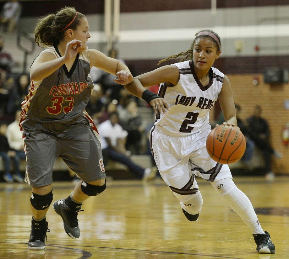Lee's Allison Valdez (2) moves the ball against Lubbock Coronado's Bailey Walden (33) on Tuesday, Nov. 24, 2015, at Lee High. James Durbin/Reporter-Telegram Photo: James Durbin