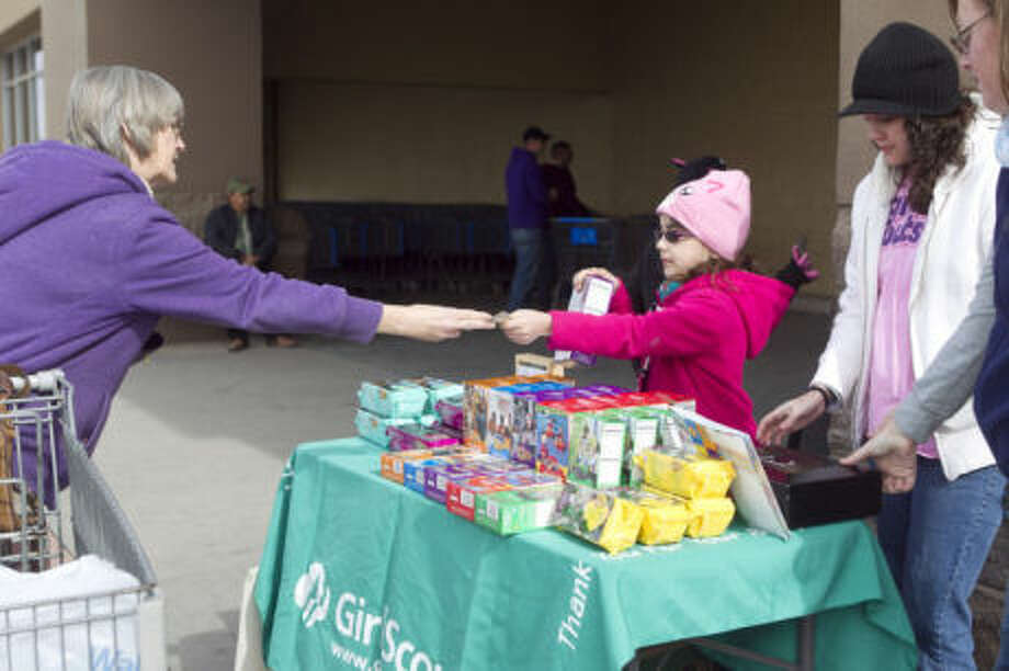 "- Door-to-door sales: Girl Scouts sell cookies in their neighborhoods, communities and to family and friends. If you don't know a Girl Scout, call the council at 915-566-9433 to get in touch with a troop in your area.- Booth sales: Troops run cookie booth sales at various locations around Midland. Sales run Jan. 25 to March 2, from 4-7 p.m. Monday-Friday and 9 a.m. to 7 p.m. Saturday-Sunday. Locations include Wal-Mart, Sam's Club, Lowe's, Walgreens, Orange Leaf, Community National Bank, Town and Country Shopping Center and Bear Claw Knife & Shear. For a complete list of locations, contact the council.- Order by phone: Call the Girl Scout Cookie Hotline toll-free at 800-895-7390 to place an order. - Smartphone app: Download ""Girl Scout Cookie Finder,"" available on iPhone and Android, to pinpoint the cookies closest to you. Photo: File Art By James Durbin"