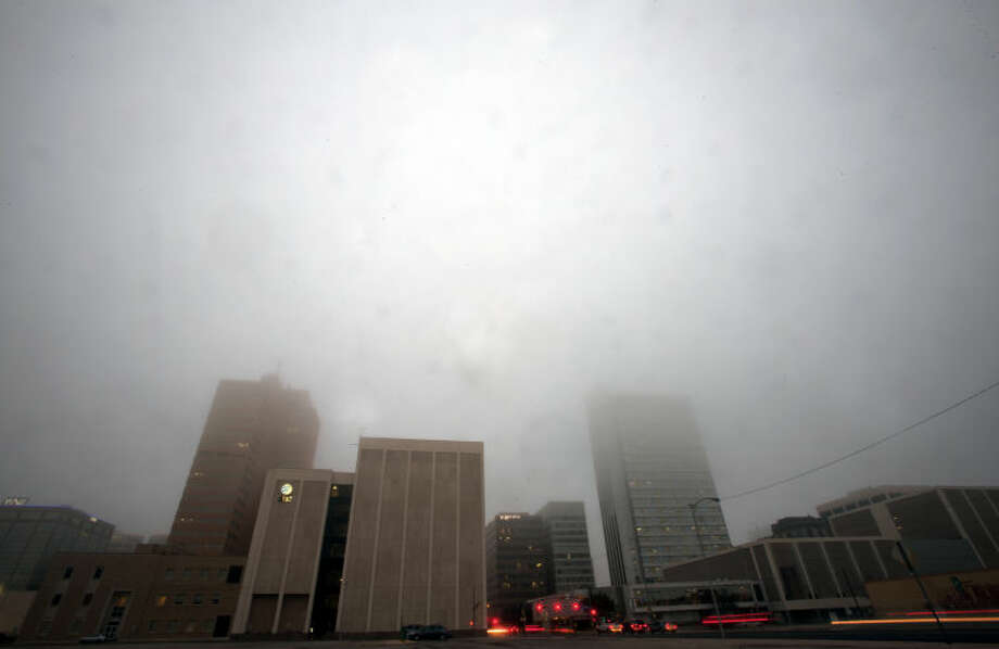 Midland downtown skyline in fog, photographed Feb. 3, 2014. James Durbin/Reporter-Telegram Photo: JAMES DURBIN