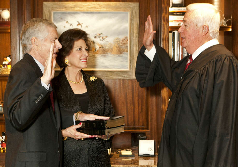 State Representative District 82 Tom Craddick is sworn into office with his wife Nadine by 441st District Court Judge Rodney Satterwhite on Tuesday, Jan. 13, 2015 at the Craddick residence. James Durbin/Reporter-Telegram Photo: James Durbin