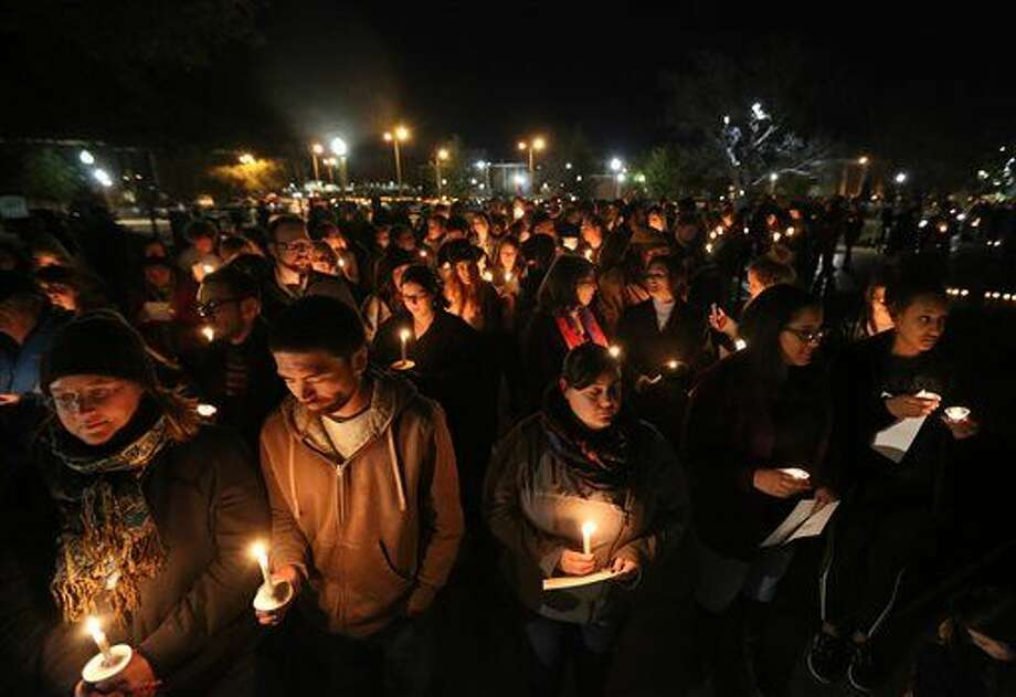 "FILE - In this Monday, Feb. 8, 2016 file photo, Baylor students and alumni hold a candlelight vigil outside the home of Baylor University President Ken Starr in what organizers' call a ""Survivors' Stand"" in Waco, Texas. The event was held in an effort to urge changes to how the school handles sexual assault. The university did not report a single instance of sexual assault in a four-year span, according to federal statistics, a finding that represents a sharp contrast to multiple reports at two smaller private schools in Texas over the same period. (Rod Aydelotte/Waco Tribune Herald via AP, File) Photo: Rod Aydelotte"