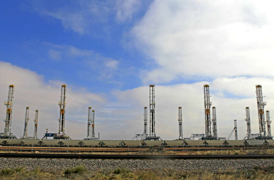 Rigs stacked along Business 20 west of FM 1788 photographed Tuesday, Feb. 24, 2015. James Durbin/Reporter-Telegram