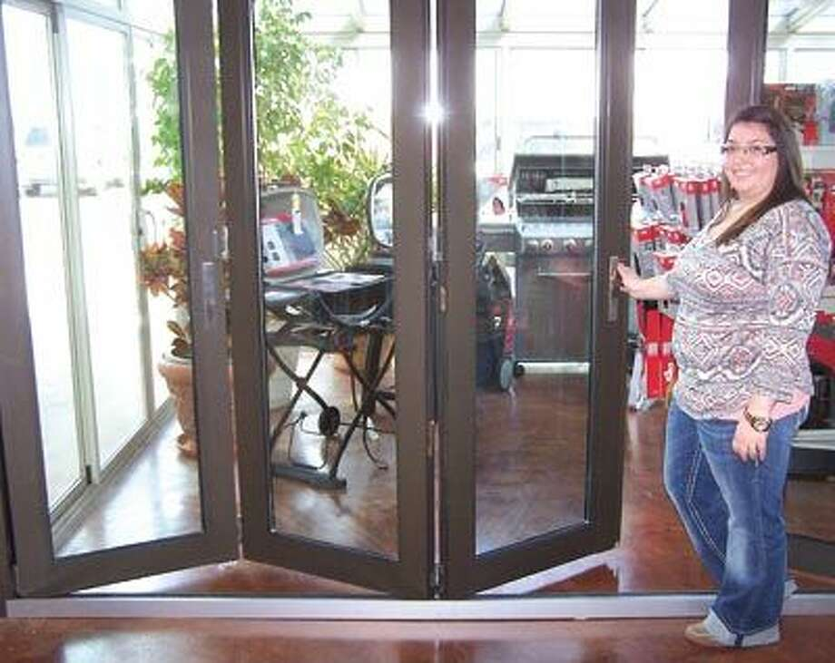 Jacy joins everyone at American Home Improvement in being excited about these new, customizable, insulated fanfold doors that open all the way when needed. See them at American Home Improvement's showroom on SH 191 and FM 1788 near the airport.