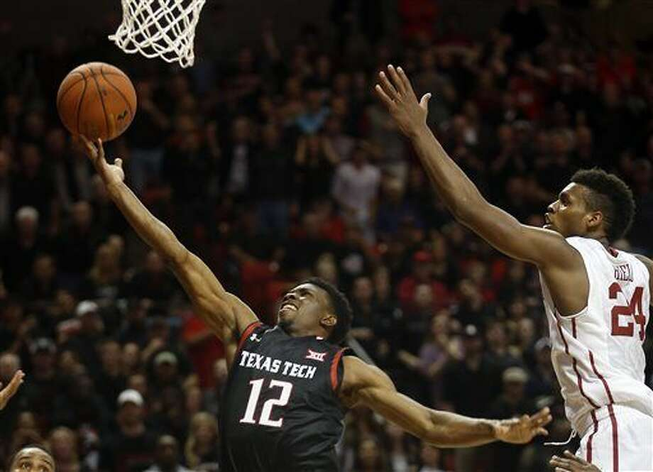 Texas Tech's Keenan Evans lays the ball up past Oklahoma's Buddy Hield during the second half of an NCAA college basketball game Wednesday, Feb. 17, 2016, in Lubbock, Texas. Texas Tech won 65-63. (AP Photo/Brad Tollefson) Photo: Brad Tollefson