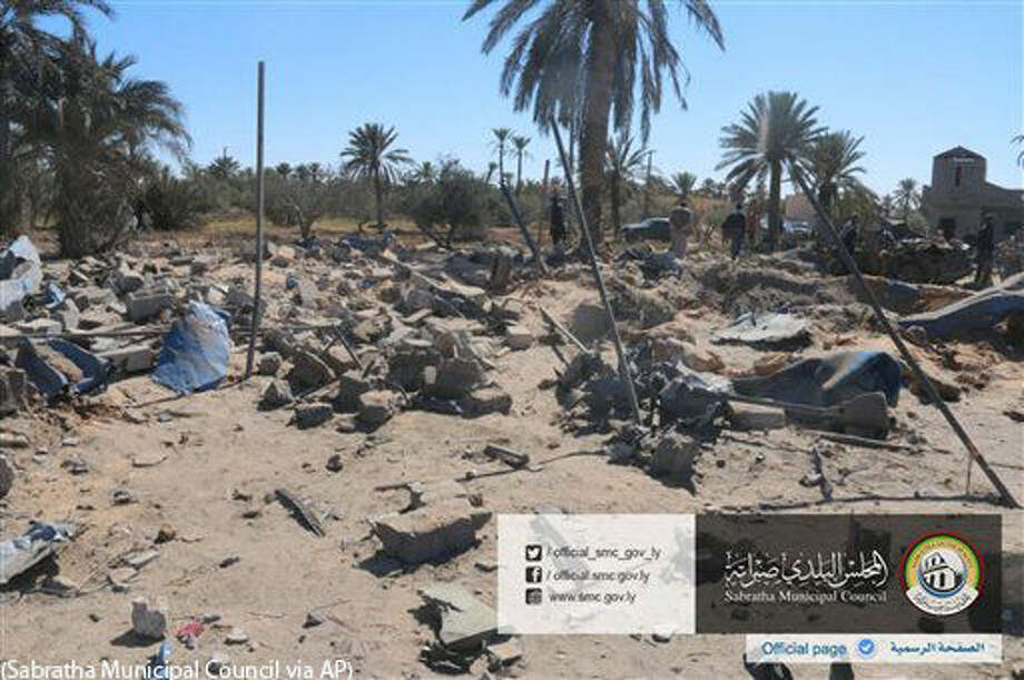 In this picture released online by the Sabratha Municipal Council on Friday, Feb. 19, 2016 shows the site where U.S. warplanes struck an Islamic State training camp in Sabratha, Libya near the Tunisian border. ATunisian described as a key extremist operative probably was killed, the Pentagon announced. In Libya, local officials estimated that more than 40 people were killed with more wounded, some critically. (Sabratha Municipal Council via AP) MANDATORY CREDIT Photo: (Sabratha Municipal Council Via AP)
