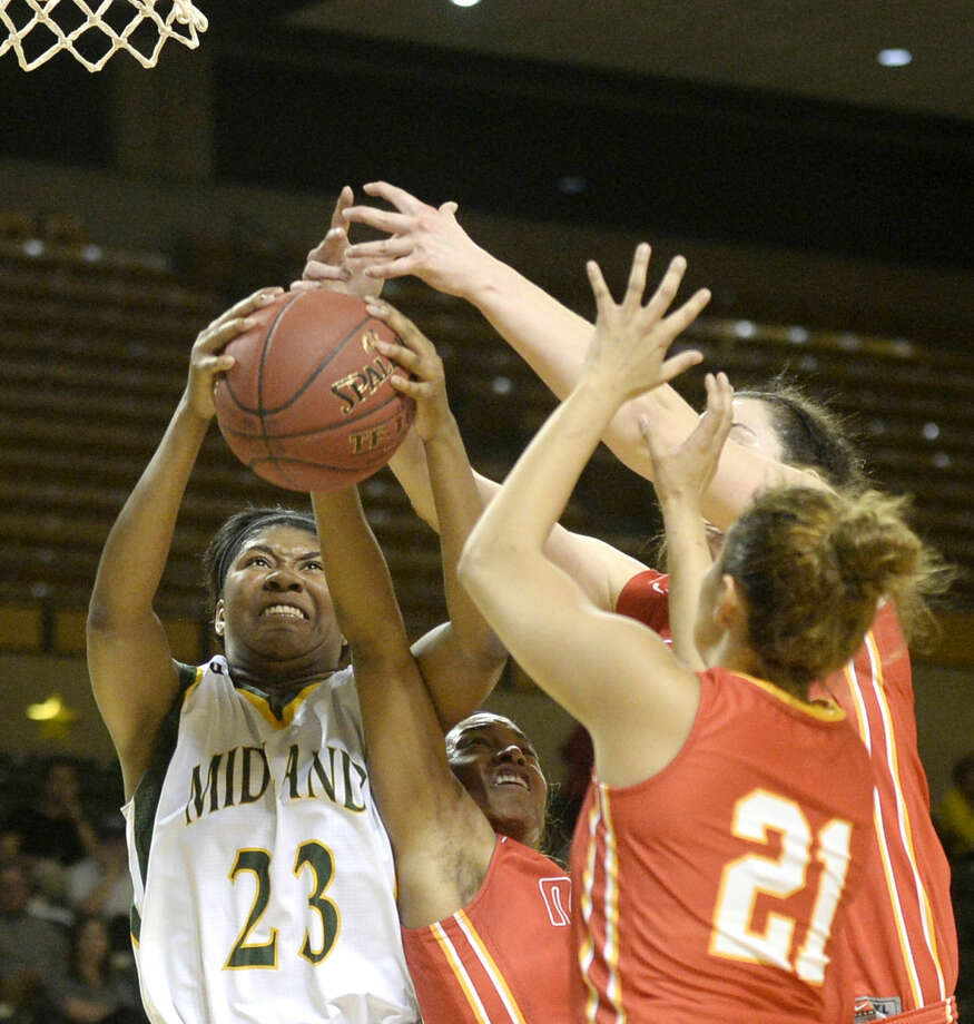 Midland College's Tichina Coleman (23) fights for a rebound against New Mexico Junior College's Ashley Perez (21), Daiane Machado (40) and Camille Mills (20) on Thursday, Feb. 18, 2016, at Chaparral Center. James Durbin/Reporter-Telegram Photo: James Durbin