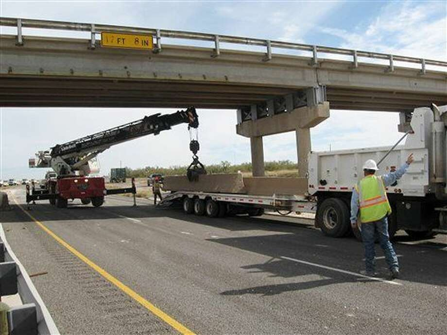 FILE - In this Nov. 7, 2013 file photo provided by the Texas Department of Transportation, work continues in the area near a collapsed overpass on Interstate 20 near Big Springs, Texas. (AP Photo/Texas Department of Transportation, File ) Photo: HOPD