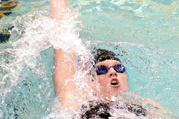 Midland High's Kile Carriger competes in the women's 200 yard IM event during the District 3-6A swimming and diving meet on Saturday, Jan. 3, 2016 at the Mabee Aquatic Center. James Durbin/Reporter-Telegram