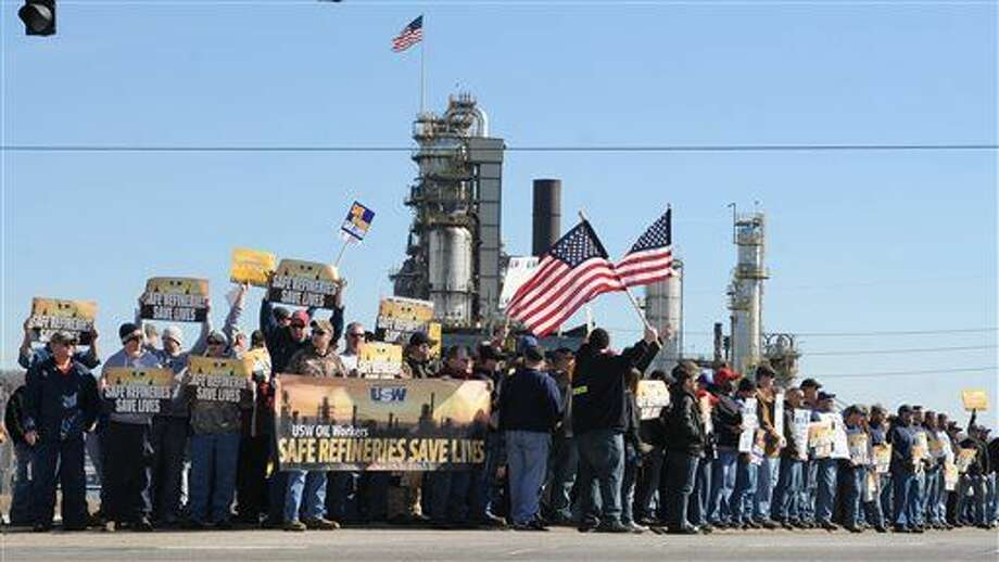Representatives from the United Steel Workers Union (USW) hold a rally at the entrance to the Marathon refinery in Catlettsburg, Ky. Saturday Feb. 7, 2015. About 3,800 steelworkers began a strike Feb. 1 at refineries from California to Kentucky, saying that negotiations with Shell Oil Co. had broken down. Shell is negotiating the national contract for other oil companies. (AP Photo/The Independent, Kevin Goldy) Photo: Kevin Goldy