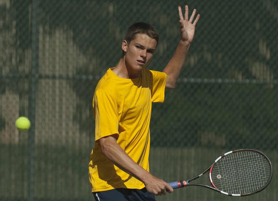 El Paso Coronado's Nathan Brown returns a shot Friday, 2-20-15, during the Tall City Tennis Invitational at Midland College Tennis Center. Tim Fischer\Reporter-Telegram Photo: Tim Fischer