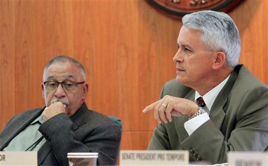 Sen. Clemente Sanchez, D-Grants, right, suggested the quarter-billion-dollar Spaceport America is failing due to a lack of revenue during a committee meeting in Santa Fe, N.M., on Thursday, Feb. 19, 2015. The Senate Corporations and Transportation Committee on Thursday advanced without recommendation a bill that calls for selling the spaceport. (AP Photo/Susan Montoya Bryan) Photo: Susan Montoya Bryan