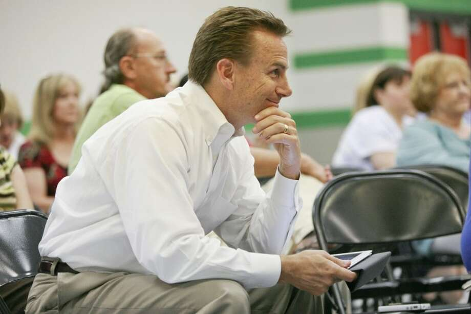 Stonegate Fellowship Senior Pastor and MISD advocate Patrick Payton listens Tuesday during a town hall meeting at Greathouse Elementary as residents talk about the possible addition of a third high school. Photo: MRT File Photo