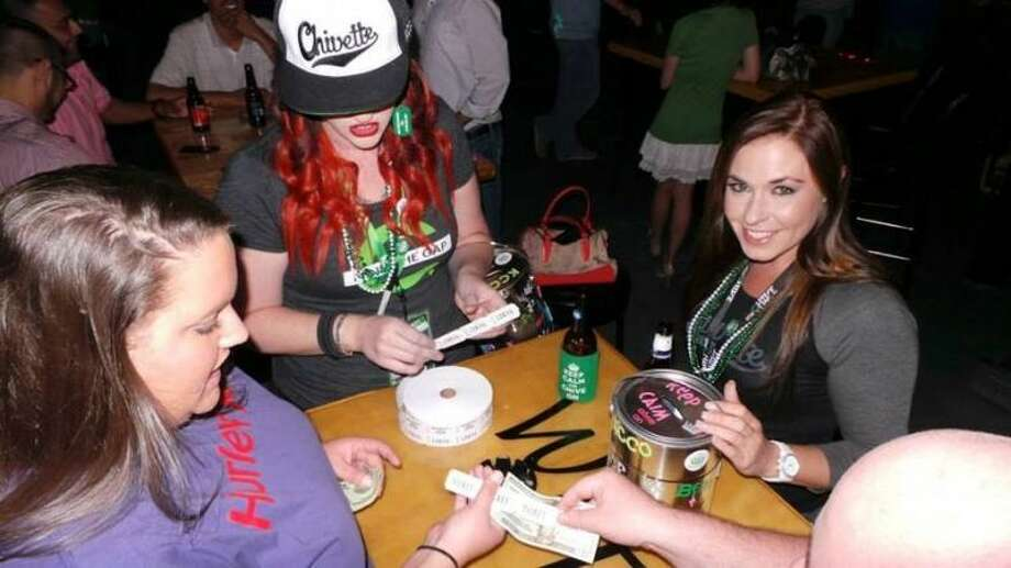 Chivettes Trish Jones and Candace Topham sell raffle tickets at a Midessa Chivers gathering. Photo: Courtesy Photo