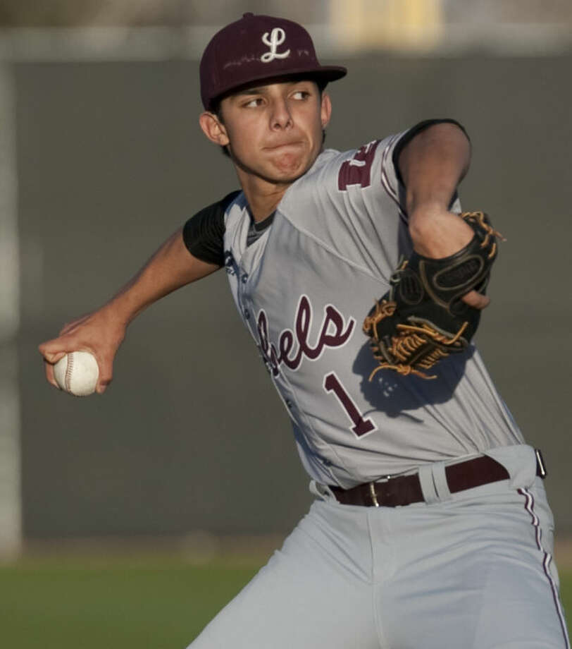 Lee High's Evan Mata pitches against Midland High on March 11, 2014 at Christensen Stadium. Tim Fischer\Reporter-Telegram Photo: Tim Fischer