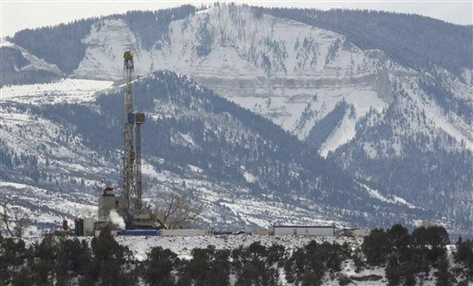 In this photograph taken Thursday, Feb. 28, 2013, near Parachute, Colo., the drill rig at a natural gas site stands with mountains in the background on Colorado's Western Slope. Photo: David Zalubowski