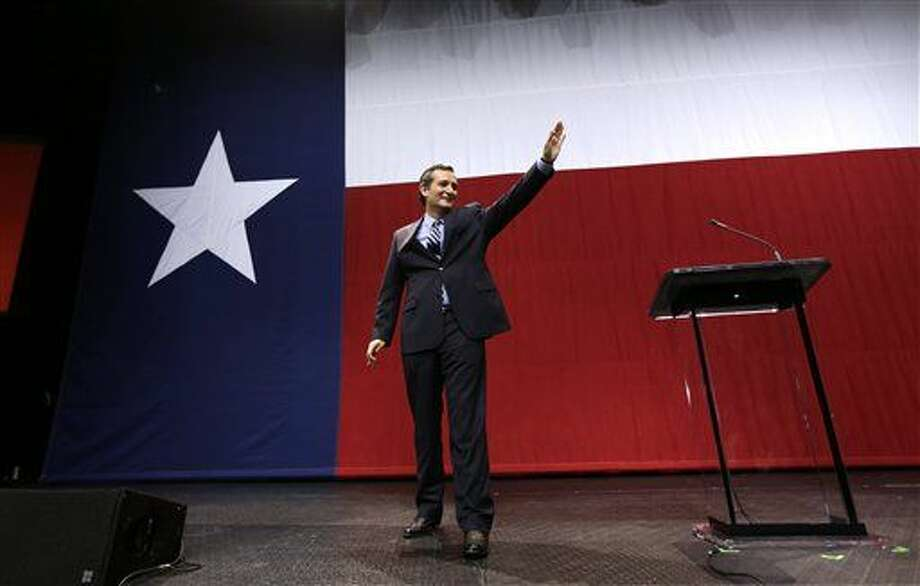 U.S. Sen. Ted Cruz, R-Texas, waves to the crowd at a Republican victory party Tuesday, Nov. 4, 2014, in Austin, Texas. (AP Photo/David J. Phillip)