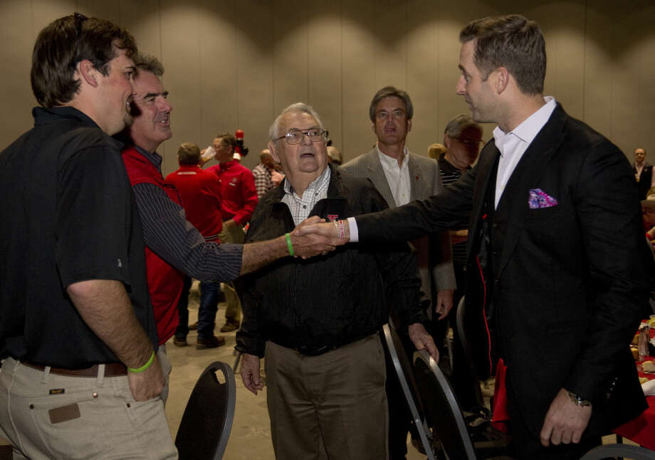 Texas Tech football coach Kliff Kingsbury, right, greets Craig Mulloy, his father John and son Cody Monday 02-15-16 at the Red Raider Club Recruiting Review at the Horseshoe Pavilion. Tim Fischer/Reporter-Telegram Photo: Tim Fischer