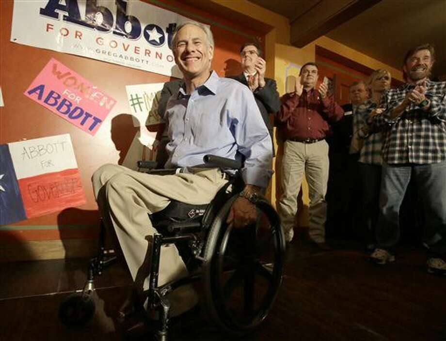 FILE - In this Nov. 3, 2014 file photo is Texas Republican Greg Abbott, left, who elected the first new governor of Texas in 14 years on Tuesday, Nov. 4 defeating Democrat Wendy Davis. (AP Photo/Pat Sullivan, File) Photo: Pat Sullivan