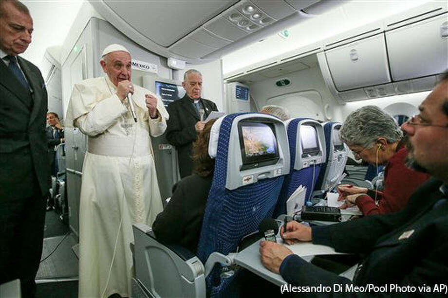 In this photo taken Wednesday, Feb. 17, 2016 Pope Francis meets journalists aboard the plane during the flight from Ciudad Juarez, Mexico to Rome, Italy. The pope has suggested that women threatened with the Zika virus could use artificial contraception but not abort their fetus, saying there's a clear moral difference between aborting a fetus and preventing a pregnancy. (Alessandro Di Meo/Pool Photo via AP) Photo: Alessandro Di Meo